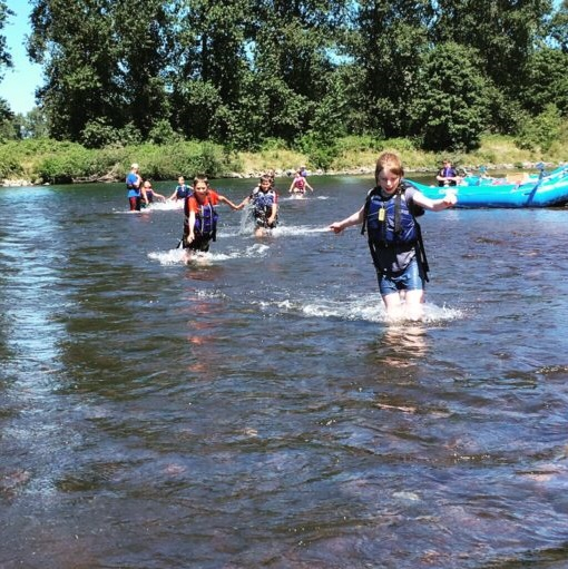 Kids ford the Willamette River together. Everyone needs a friend to lean on!