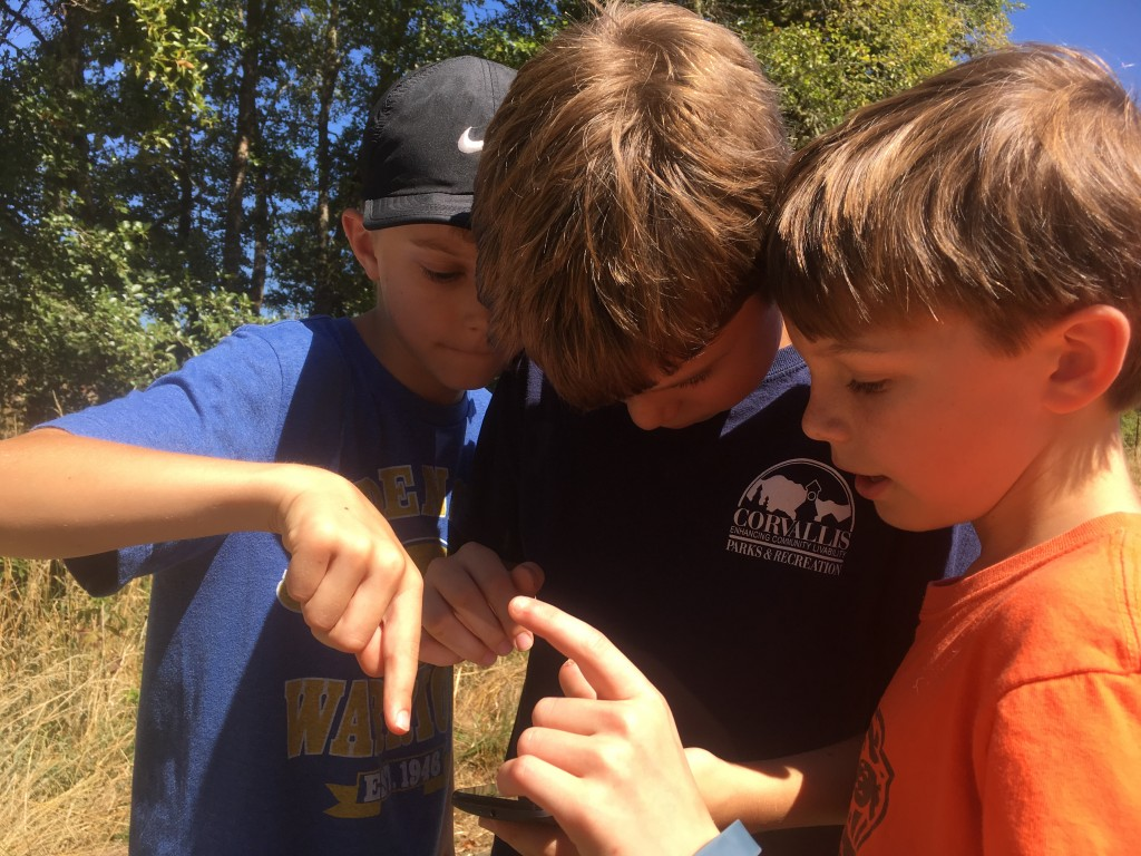 Kids work together to find Pokemon creatures and navigate the trails.